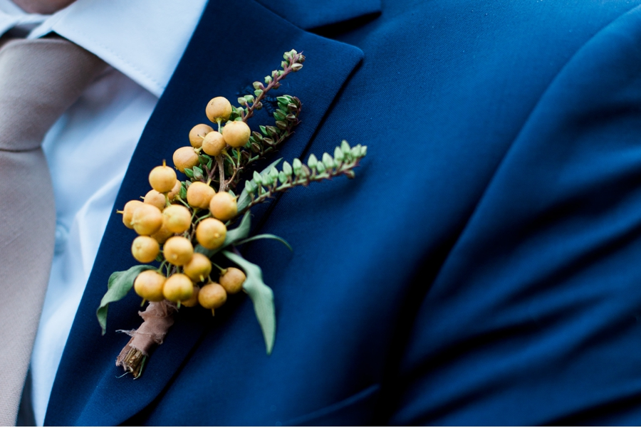 Blue-Suit-with-Yellow-Berry-Boutonierre