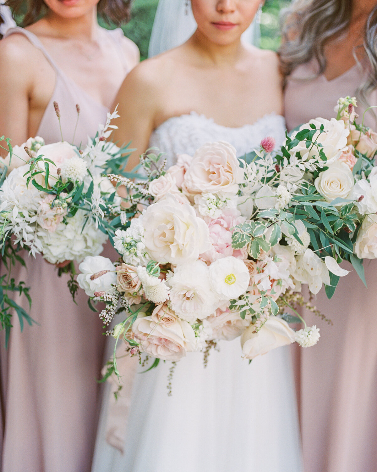 Bridesmaids bouquets in blush