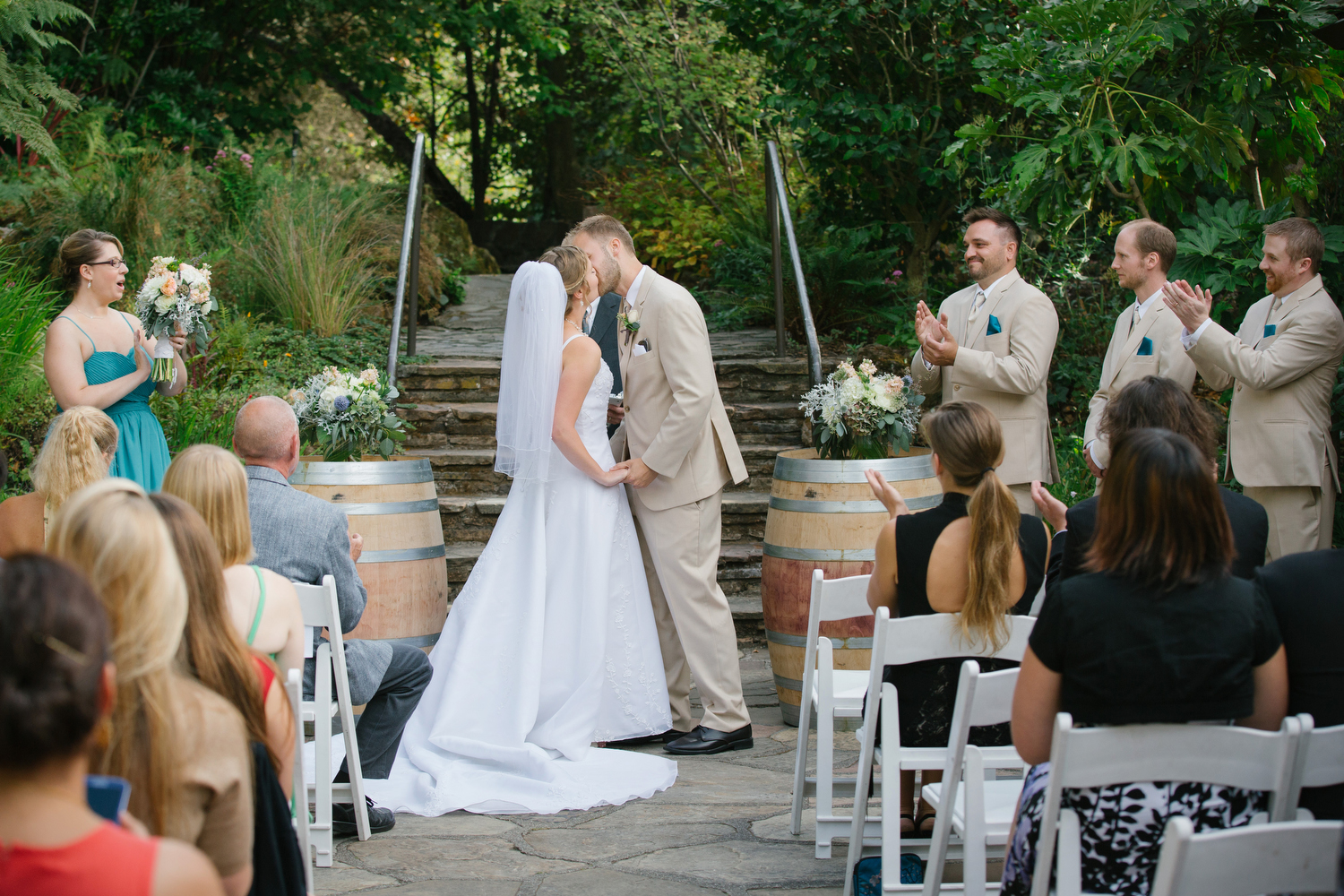 Jess and Wes kiss at their wedding at the Lake Temescal beach house in Oakland, Calif.