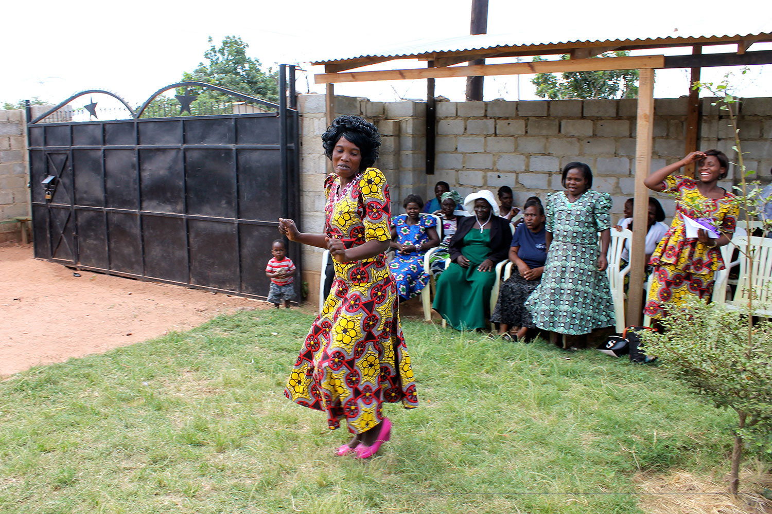 """When it comes time for the handing out of the diplomas women run (or dance, like Vene here) all the way to the front in celebration! Elina, CiH In-Country Director, shares """"This is just the start. This is just a piece of paper. YOU have the skill!"""""""