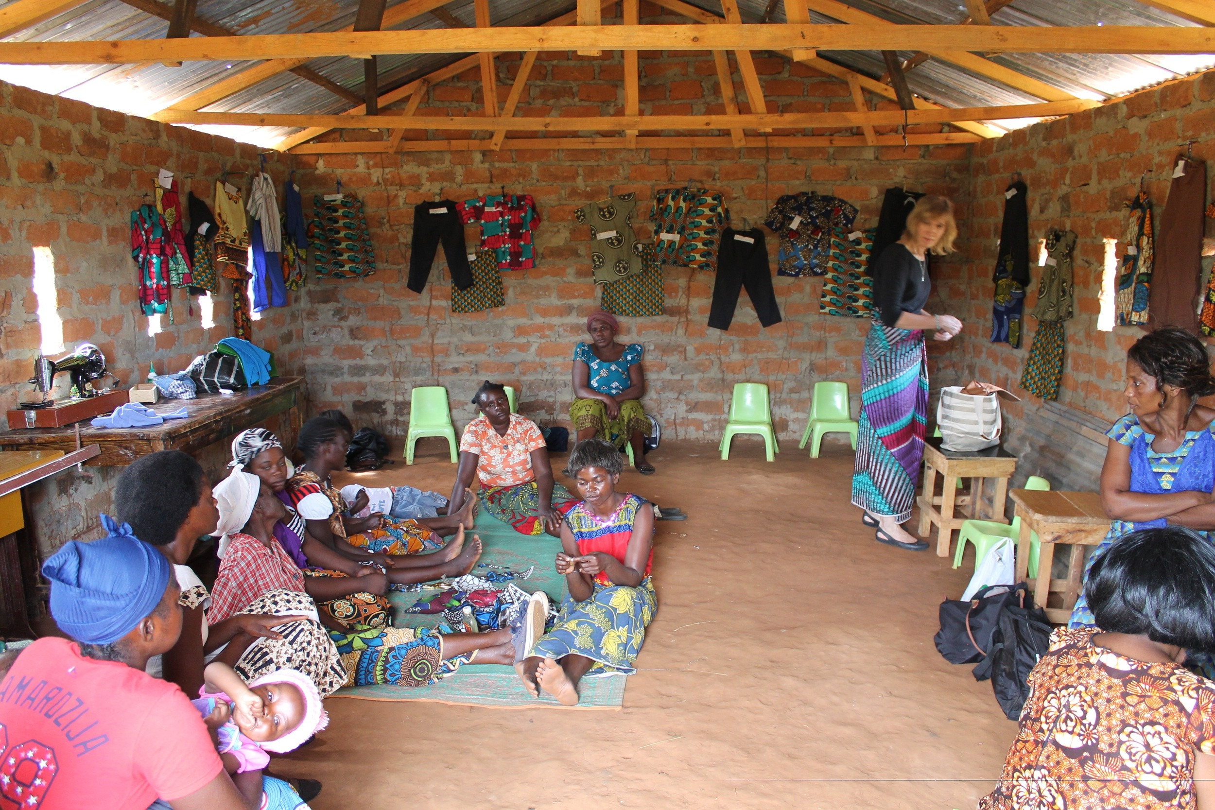 Inside, Lusaka ladies mingled with Village ladies, and we all admired the graduation test pieces adorning the walls.