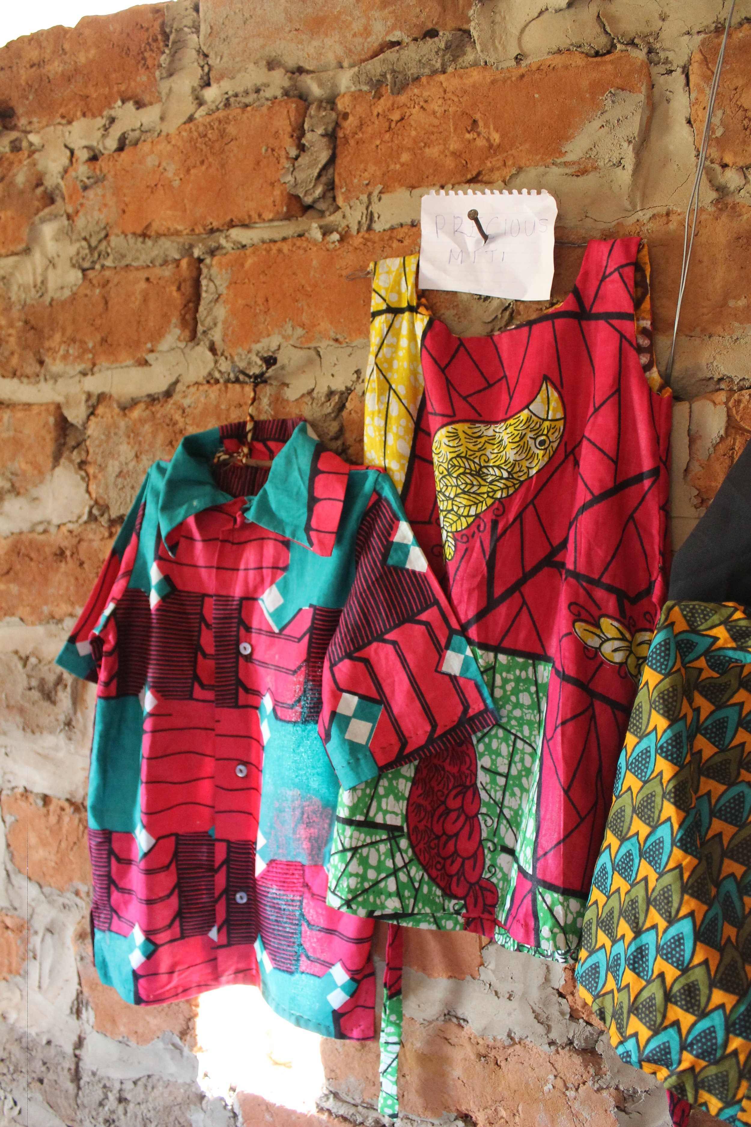 This is Precious' display of her graduation testing garments. Each woman made these without electricity, without a fancy machine, many of them stitching garments entirely by hand without patterns. Incredible stuff right there.