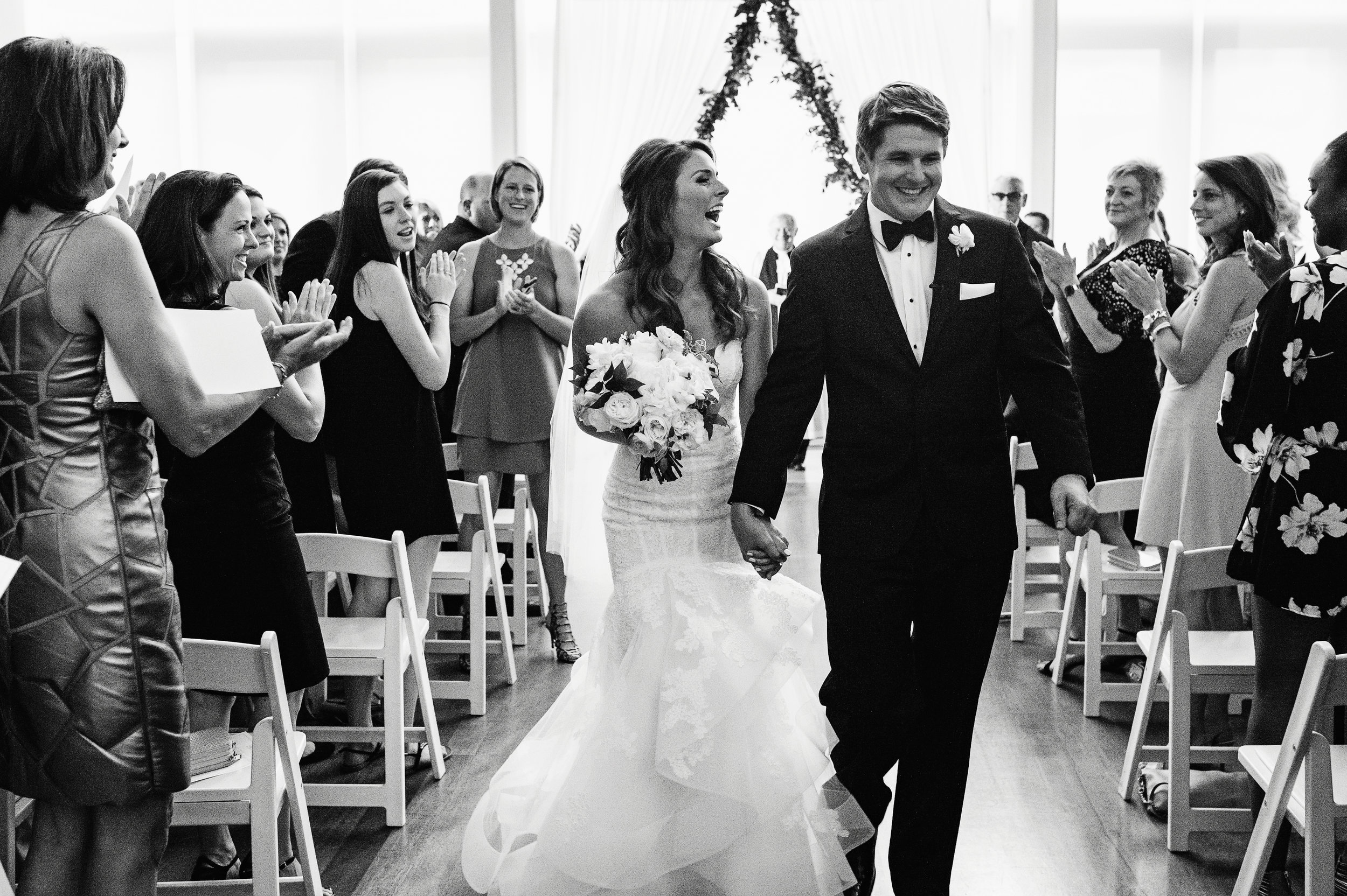 Wedding ceremony in the Atrium of the Mint Museum, Just married, Bridal hair style, Wedding hair style, Monique Lhuillier Wedding Dress, Mint Museum Uptown wedding in Charlotte, North Carolina by The Graceful Host
