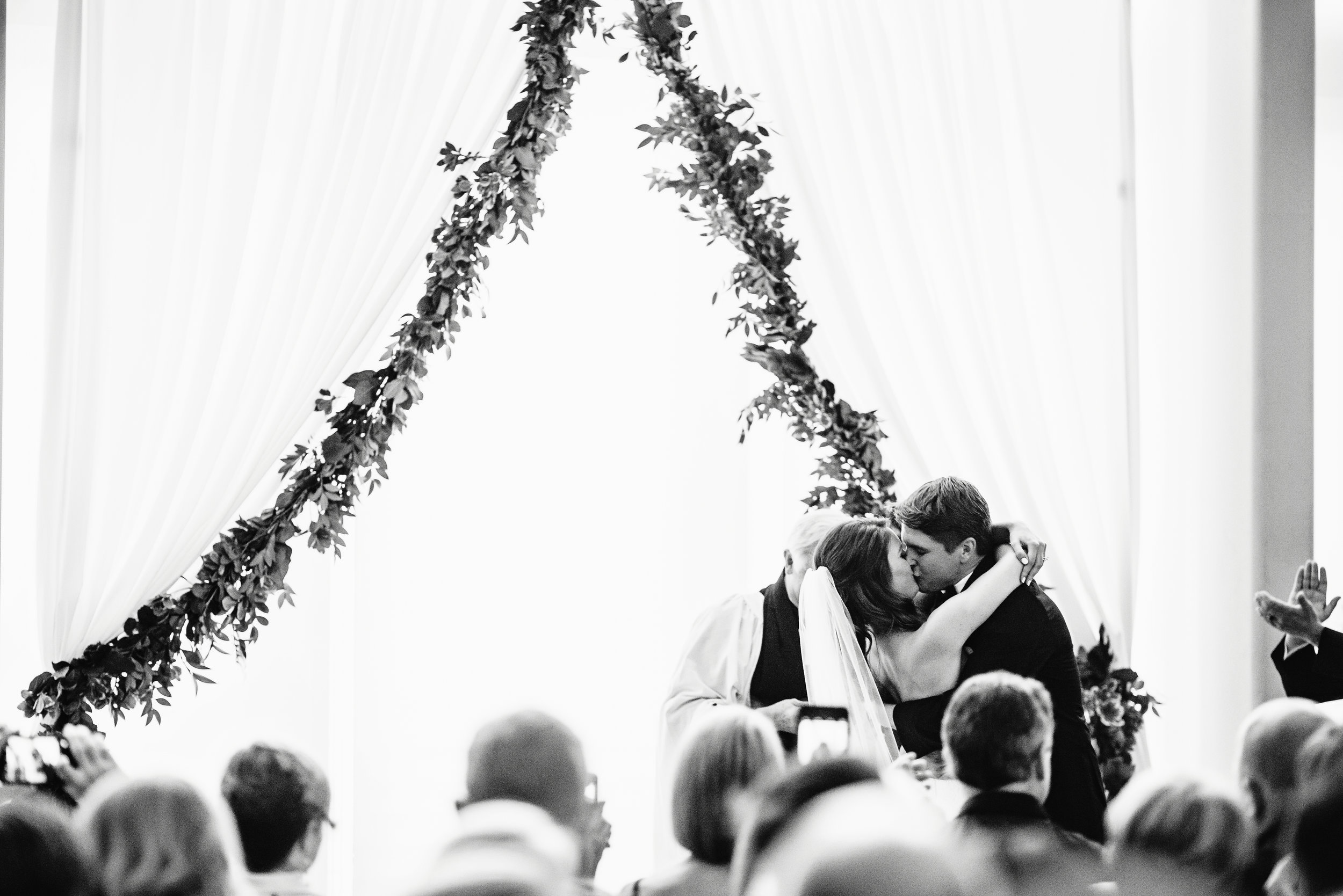 Wedding ceremony in the Mint Museum Atrium, Wedding ceremony draping, garland, Museum wedding, Mint Museum Uptown wedding in Charlotte, North Carolina by The Graceful Host