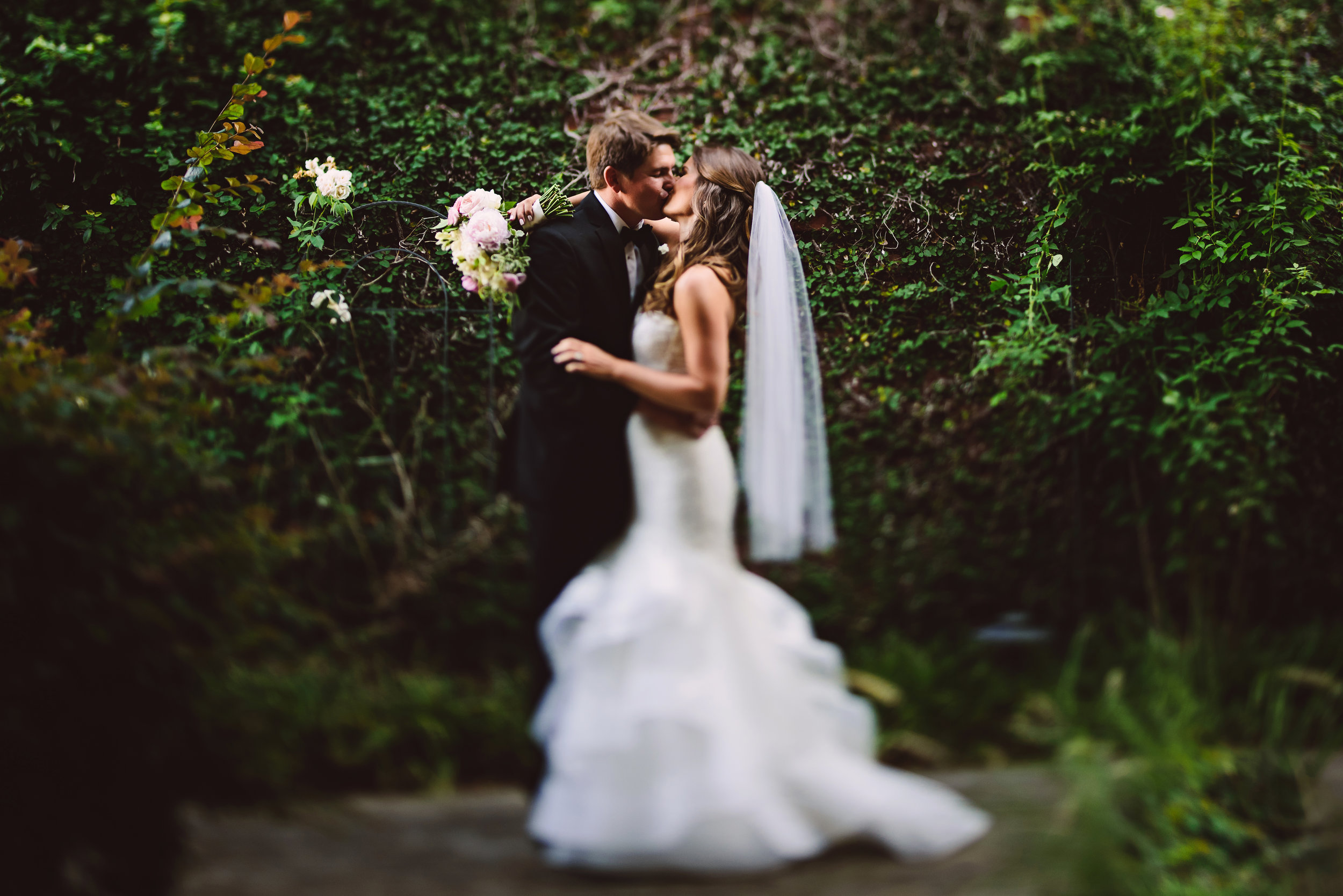 pink ivory and greenery bridal bouquet, bouquet, Monique Lhuillier wedding dress, Lace wedding dress, Bridal fashion, Wedding style, Wedding hair style, Bridal hair style, Half up half down hair style, Mint Museum Uptown wedding in Charlotte, North Carolina by The Graceful Host