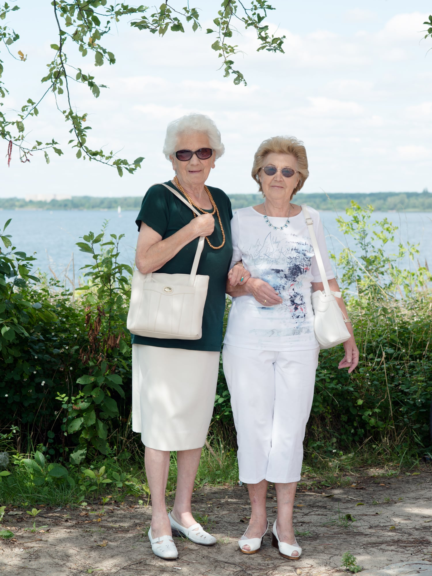 "Eleanore and Erika  Eleanore and Erika are visiting lake ""Senftenberger See"". They live in the city Senftenberg, which is bordering the lake and they remember how different it used to look here. According to them people from Senftenberg are very proud of how much the area has changed within the last years."
