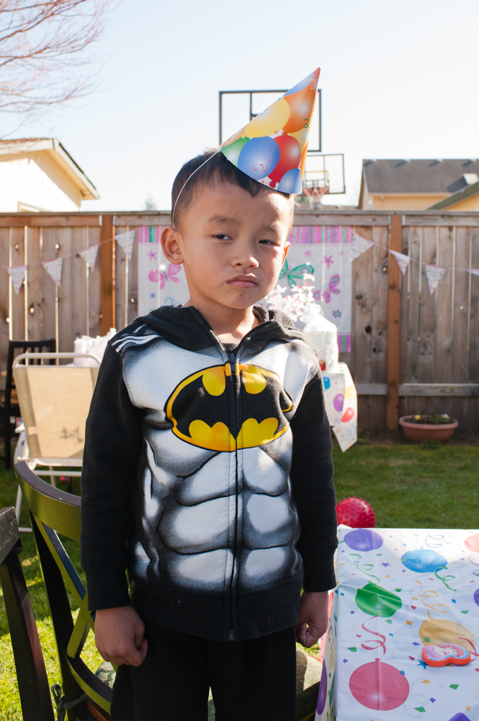 Batman, with party hat