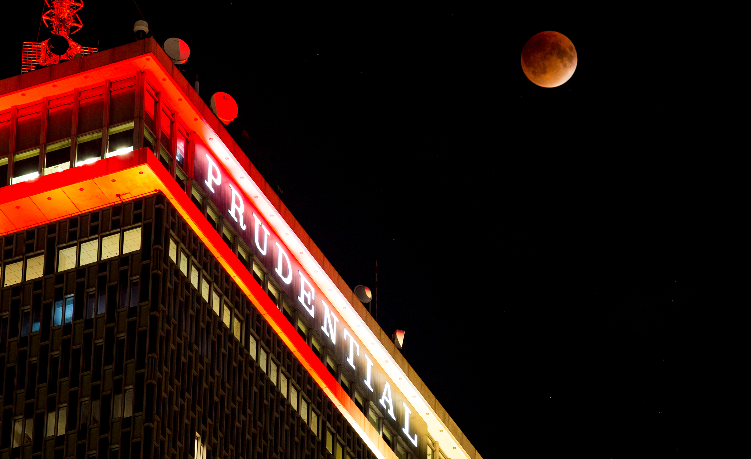 Wider shot of the Super Blood Moon over the Prudential Building in Boston