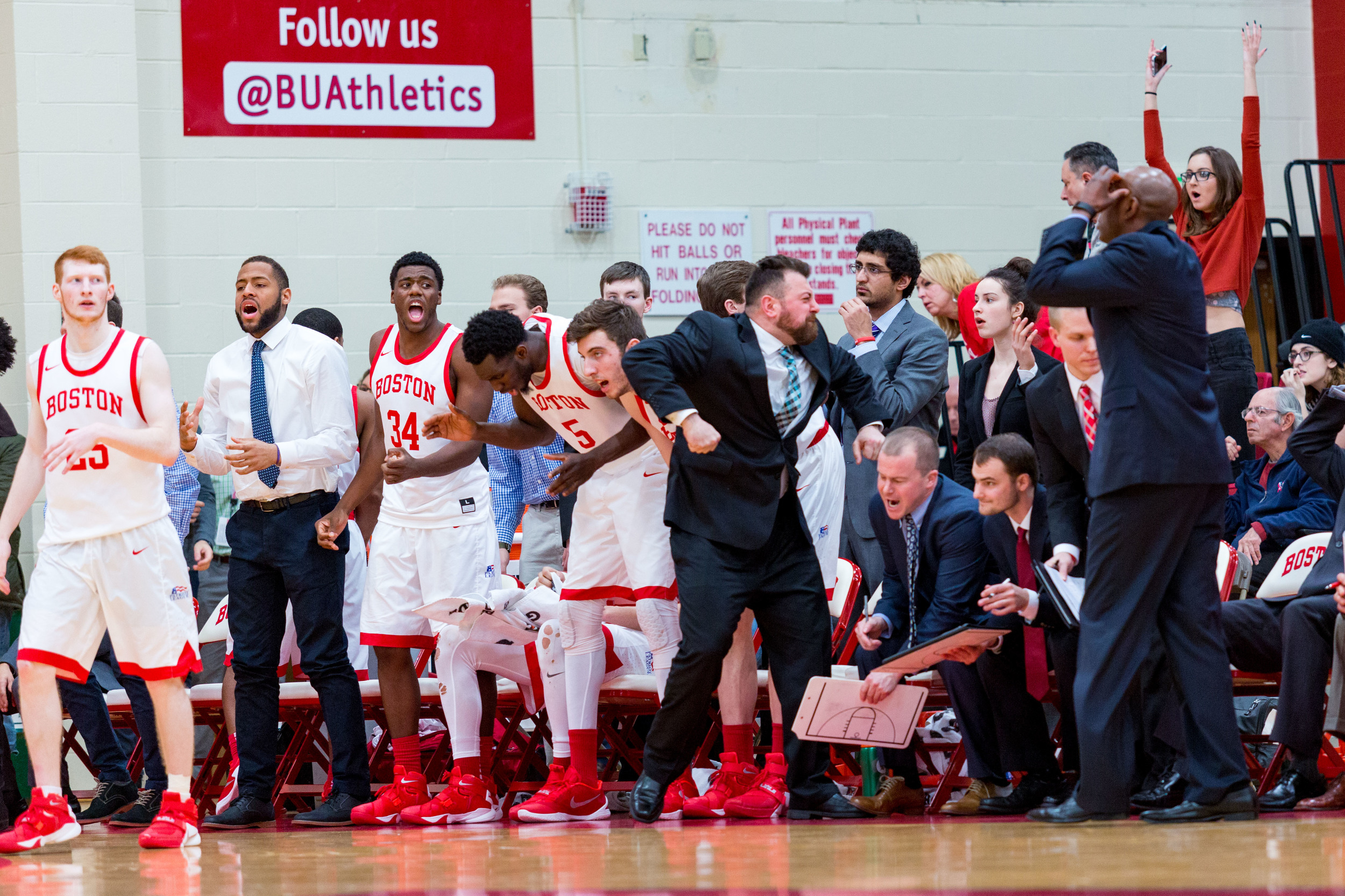 Boston University's bench can't believe they turned the ball over at the end of a tight game with Bucknell.