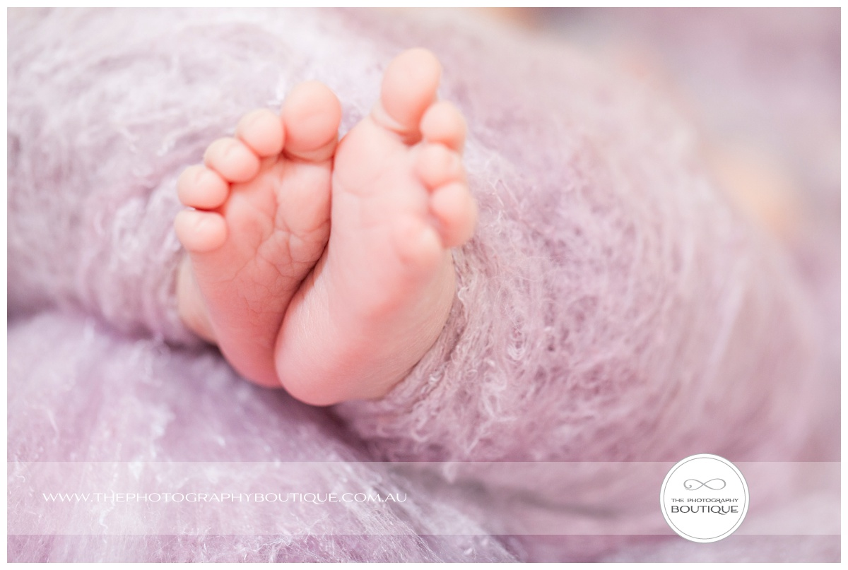 cute baby feet in pink wool wrap
