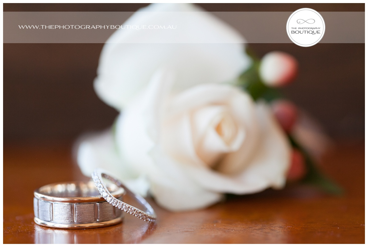 wedding rings with white buttonhole