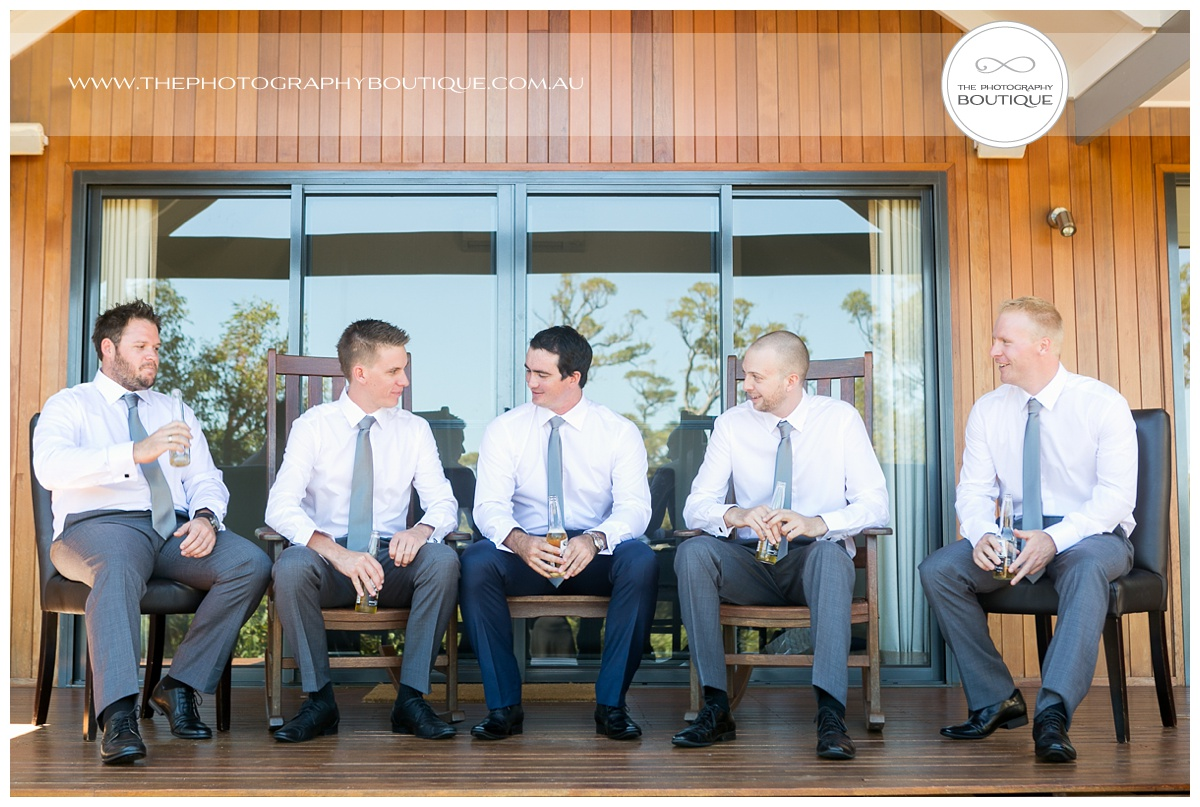 groomsmen sitting on verandah at chandewliers on abbey wedding
