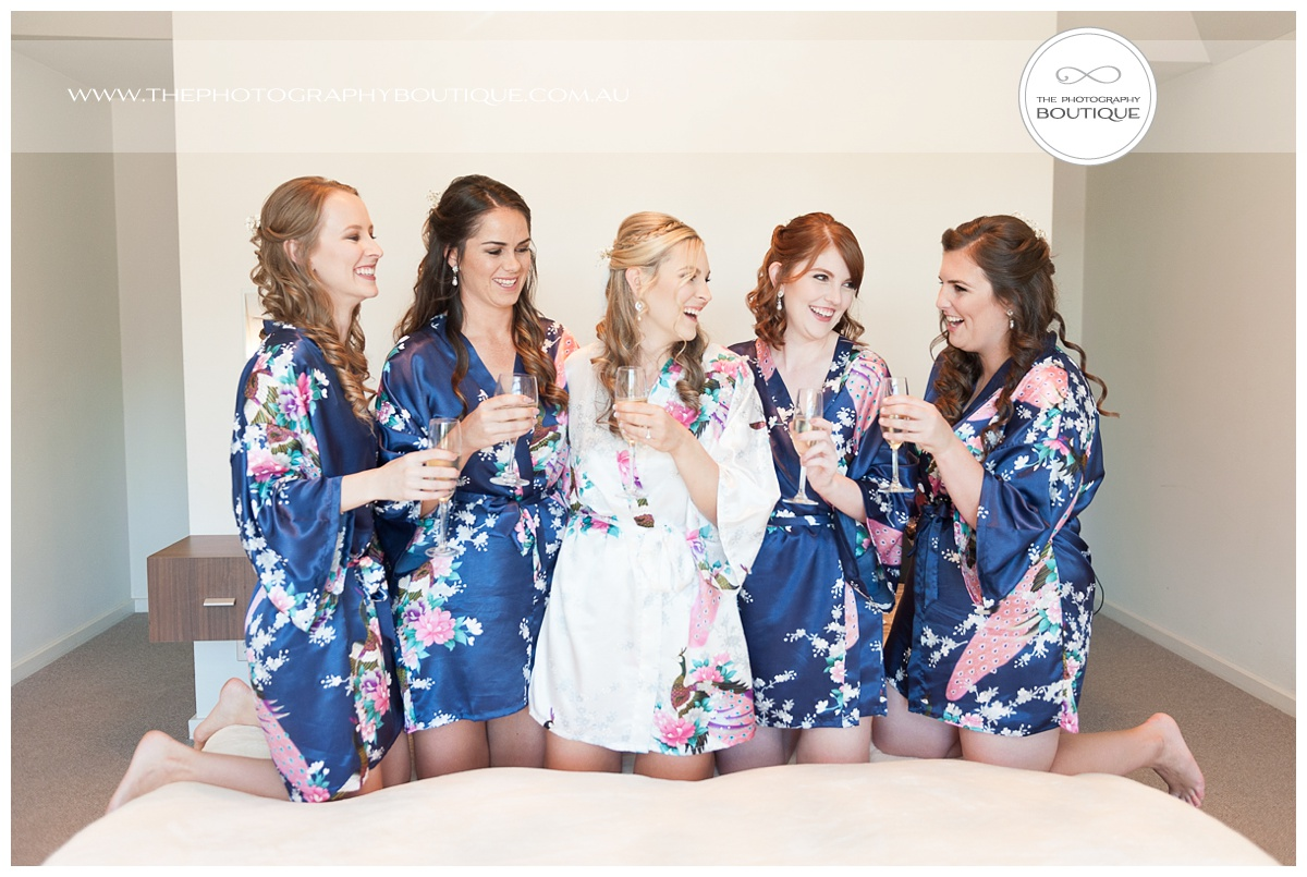 bride toasting with bridesmaids in special dressing gowns