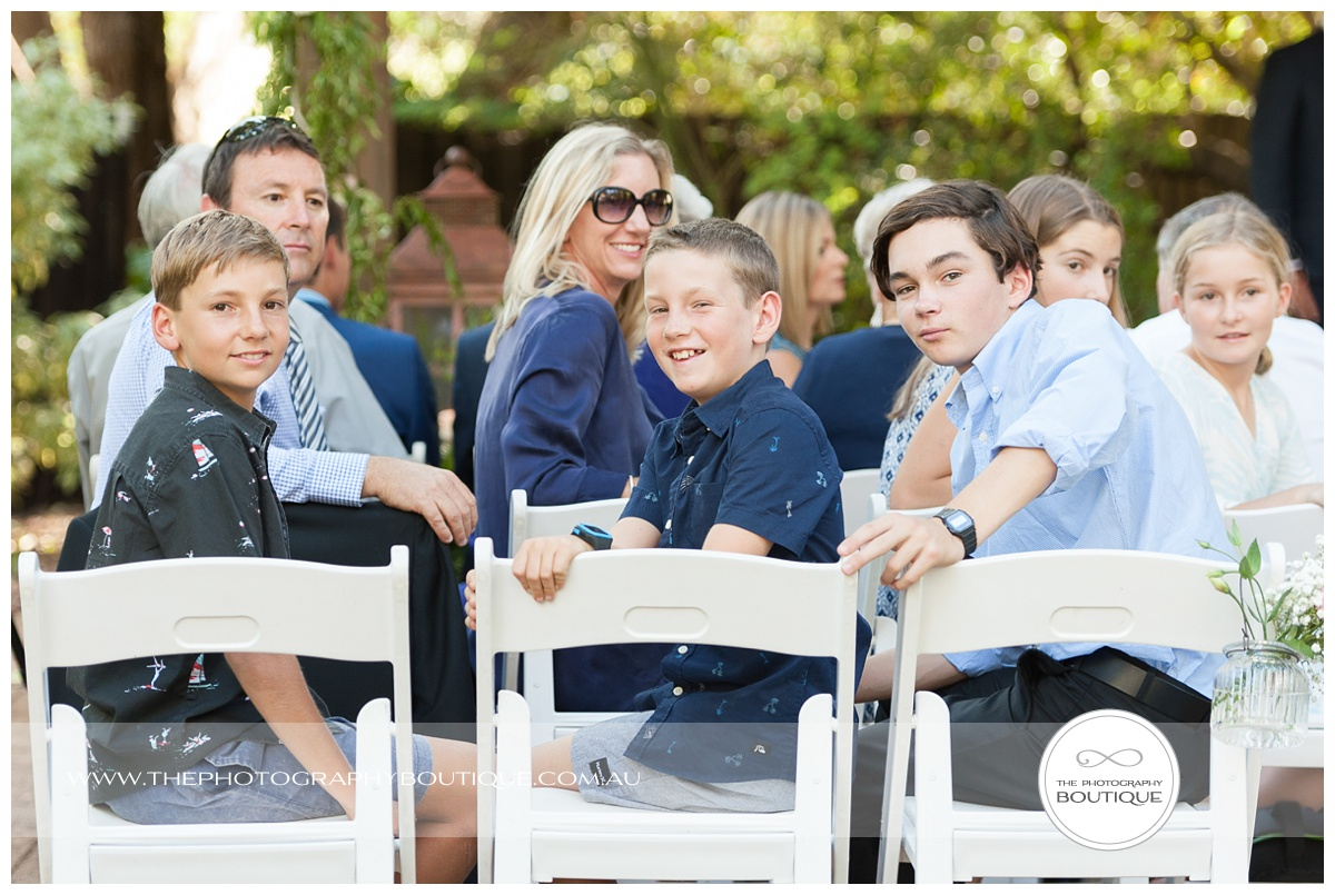 Guests watching the bride arrive at chandeliers on abbey margaret river