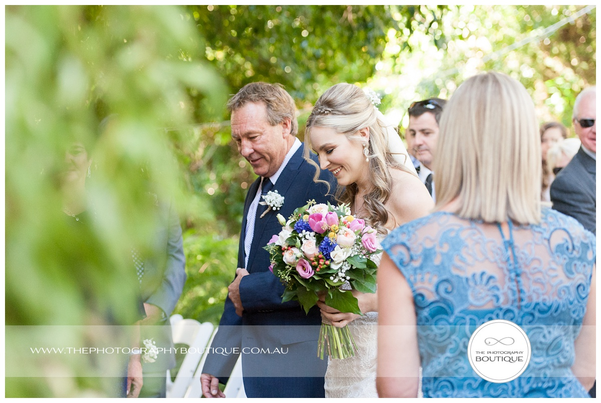 bride smiling at wedding ceremony at chandeliers on abbey margaret river