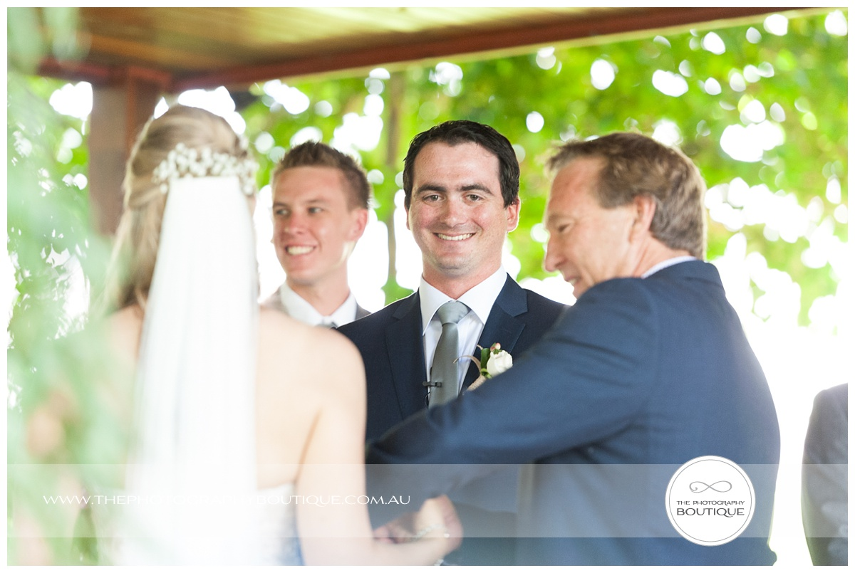 grooms face as the bride arrives at chandeliers on abbey margaret river