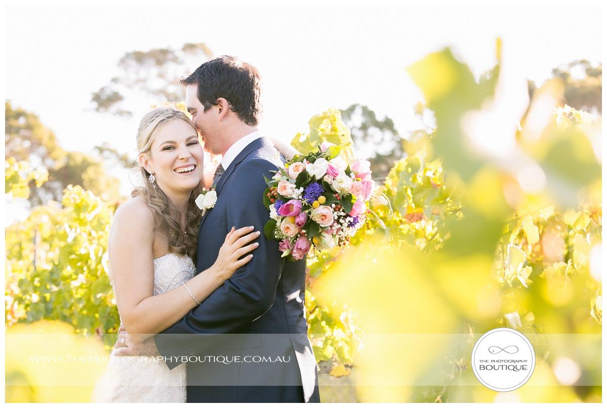 bride and groom in the vines at Windows Estate Margaret River