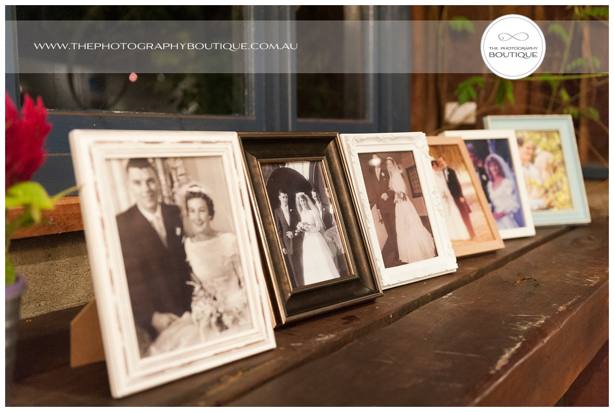 picture frames of family and grandparents as wedding styling