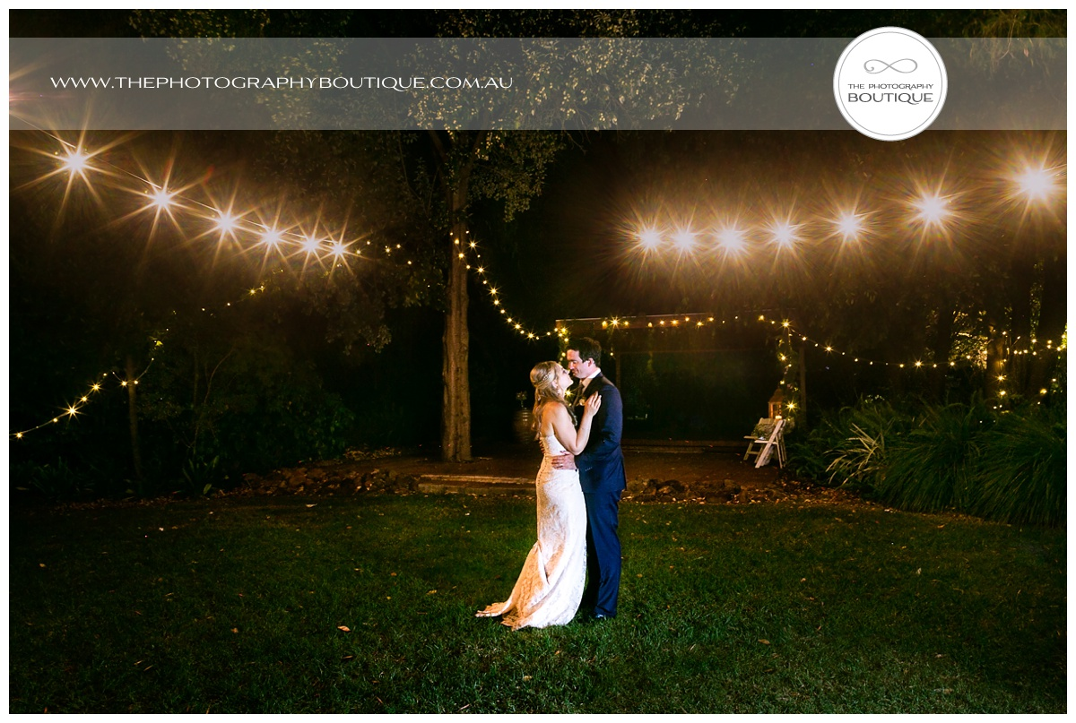 bride and groom dancing under string lanterns at chandeliers on abbey margaret river