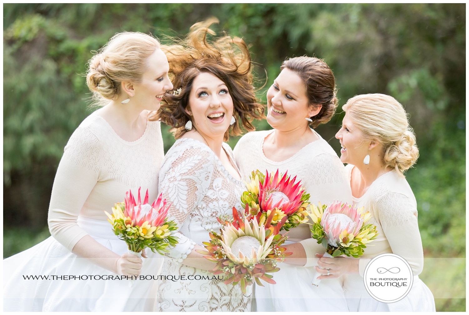 Bridesmaids laughing at bride's hair getting blown away at Caves House Yallingup