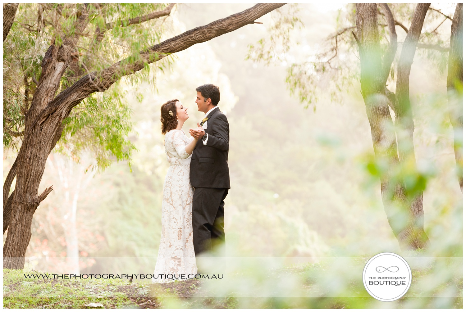 bride and groom dancing in the gardens at Caves House Yallingup
