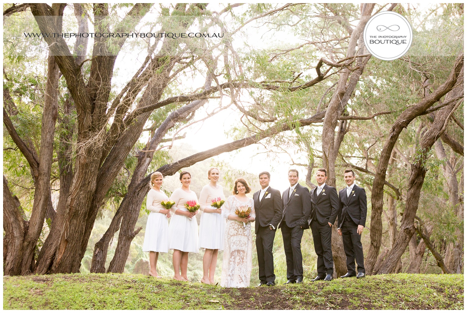 Bridal party under the trees at Caves House Yallingup