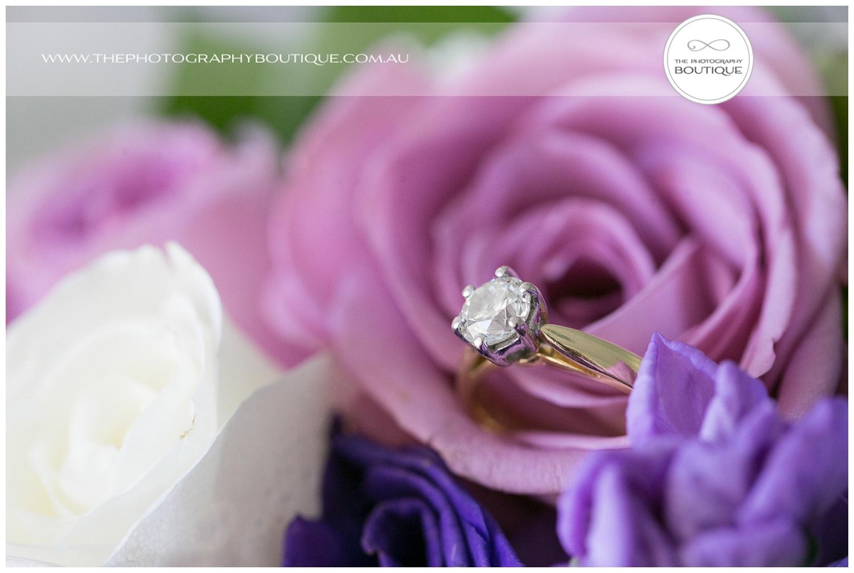 Single diamond wedding ring in flowers