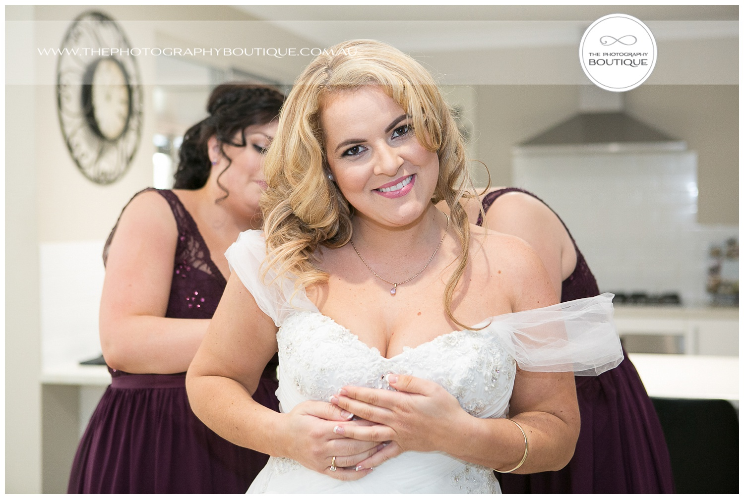 bride getting into her dress at roelands backyard wedding