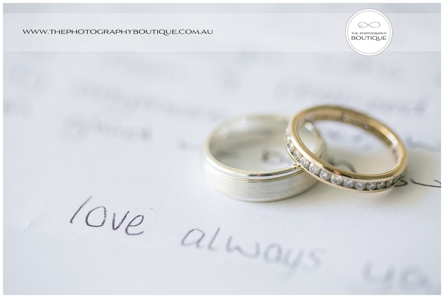 wedding rings on letter from groom to bride