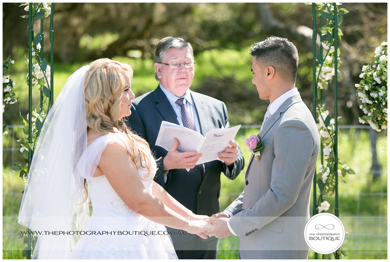 bride and groom holding hands at roelands backyard wedding