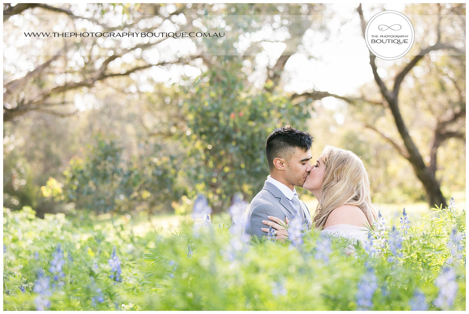 Bride and groom kissing among the flowers at Roelands Bunbury wedding