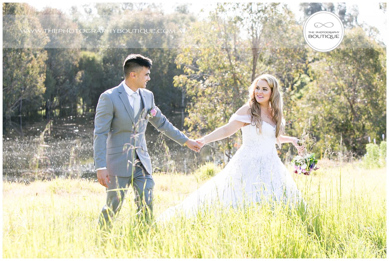 Bride and Groom walking together at Roelands Bunbury wedding