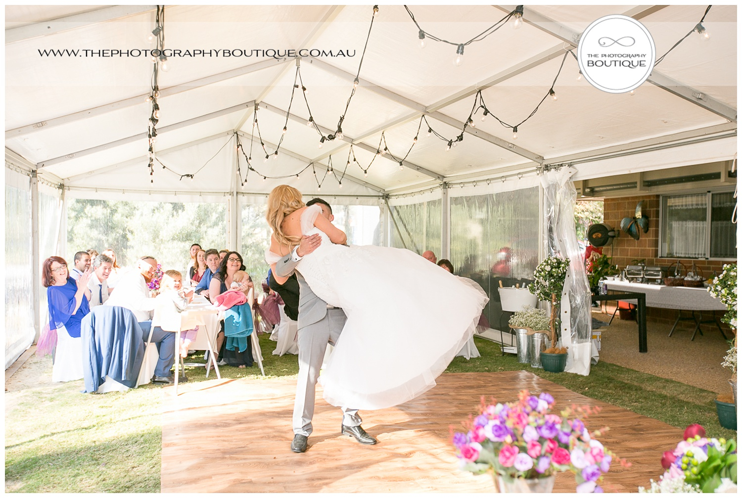 Groom lifting bride in first dance at Roelands Bunbury wedding