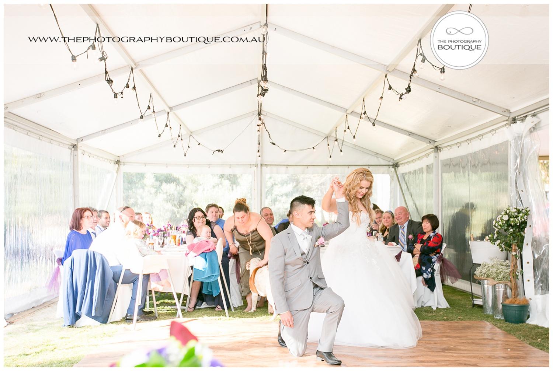 groom on one knee at Roelands Bunbury wedding