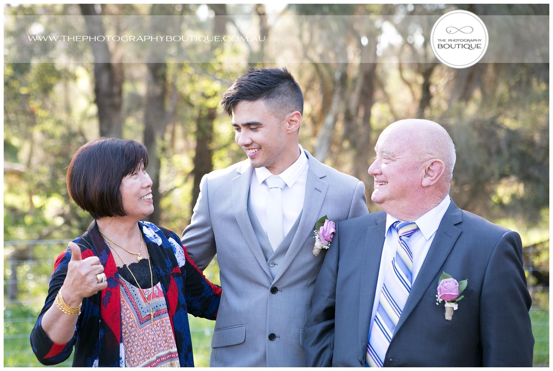 mum giving groom the thumbs up at roelands backyard wedding