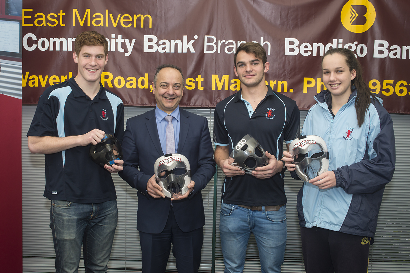 TEM Players Braden Pitcher, Will Harty & Bronte Hough pose with the masks alongside Branch Manager George Prodromidis