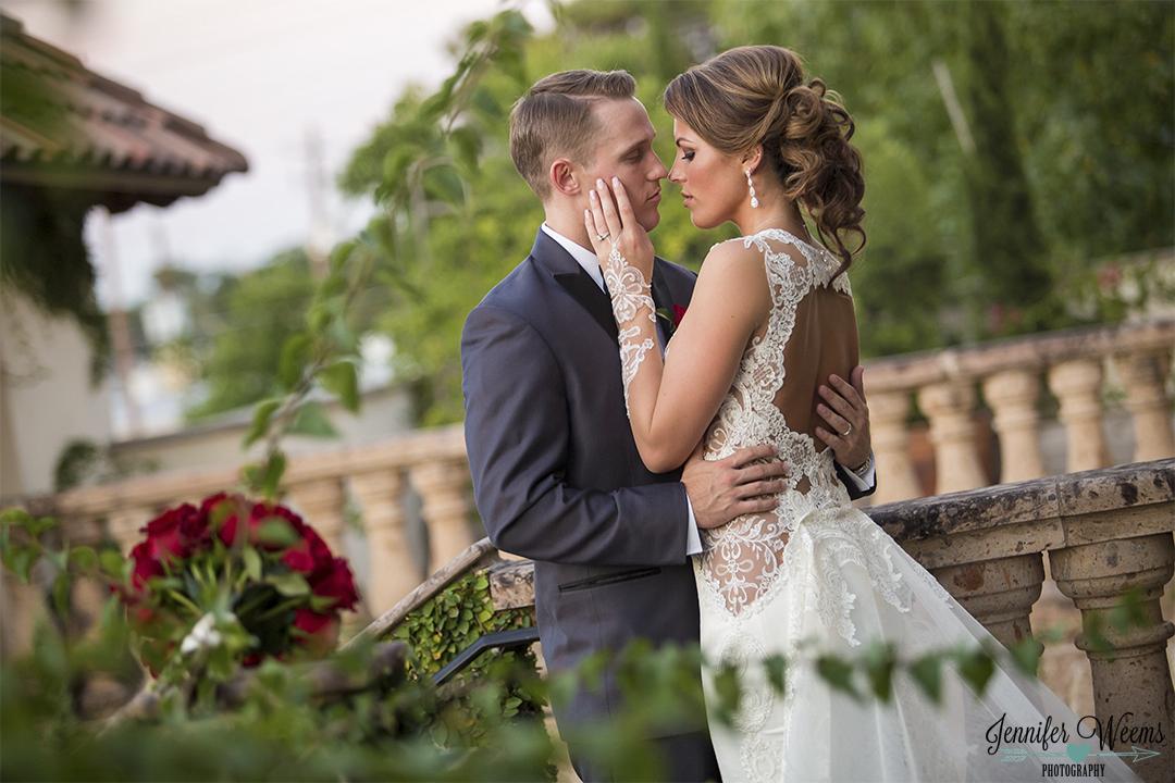 Bride and Groom Embrace on outdoor second floor of Chandelier.jpg