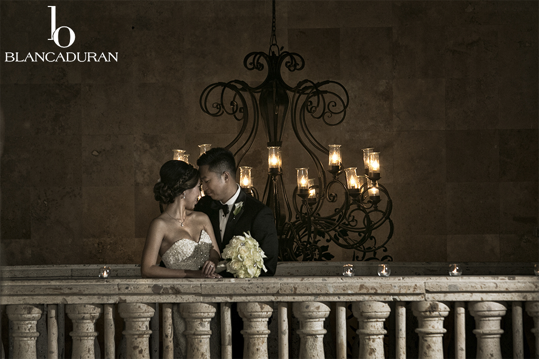 Bride and Groom Embracing on Carillon Catwalk.jpg