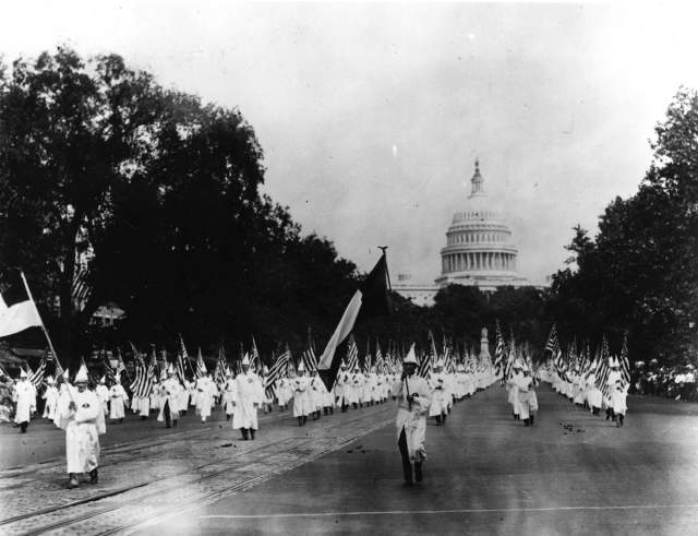 """In 1925, the Ku Klux Klan marched in Washington, DC to a """"warm reception."""" This even represents James Loewen's selection of one of """"25 Moments that Changed America"""" in the 20th century."""