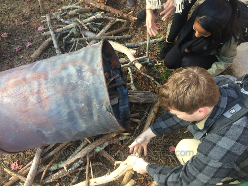 Students select the wood for the inner barrel of the retort