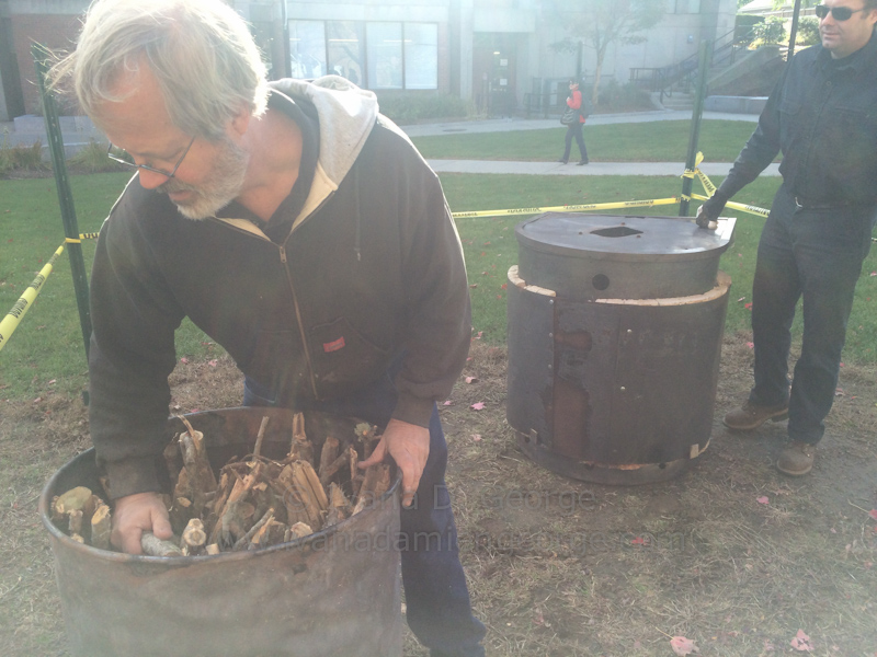 Bob Wells of New England Biochar demonstrates how to tightly pac