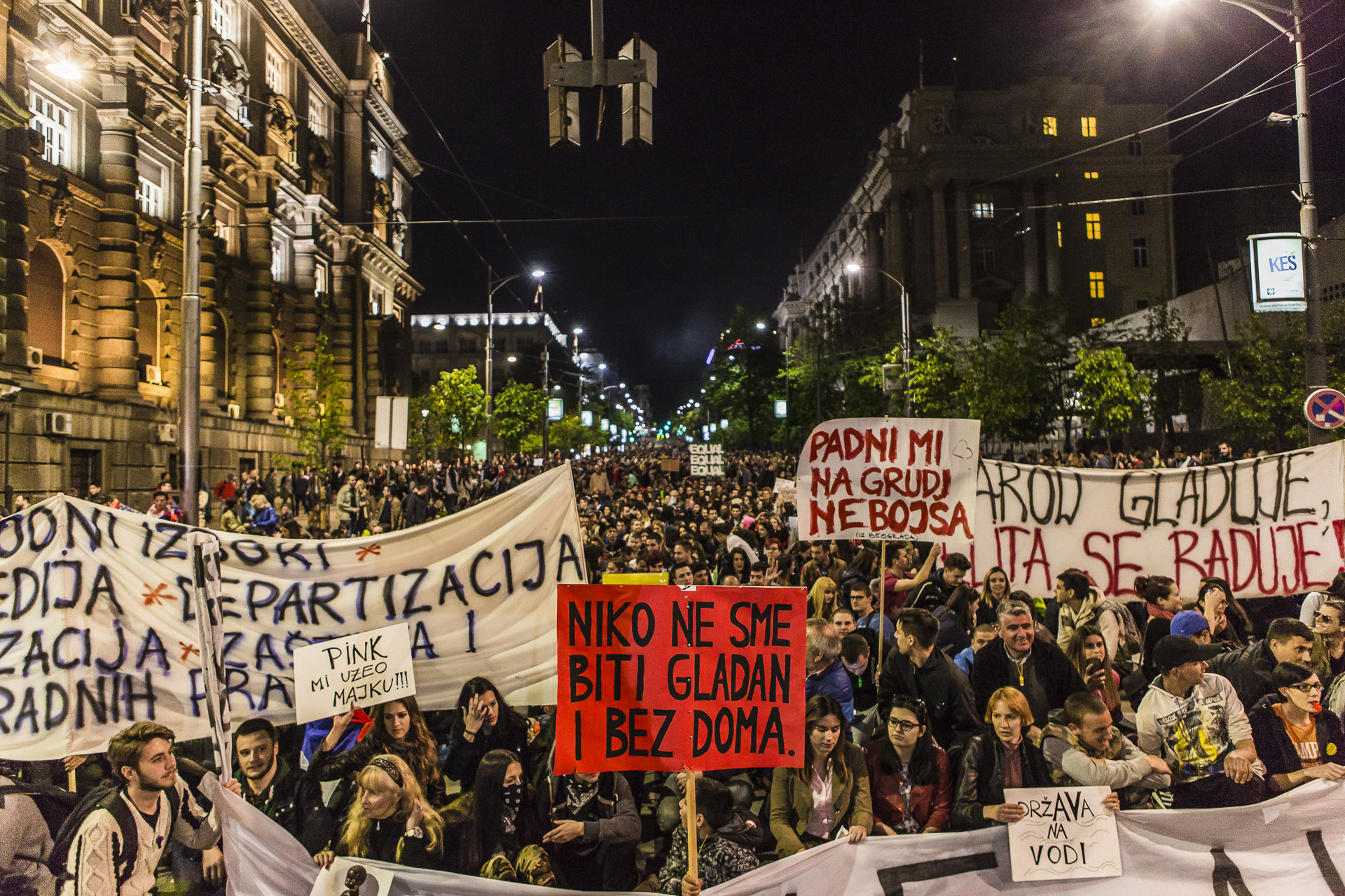 The protesters sit in front of the headquarters of the  Serbian Progressive Party of Vucic (SNS),