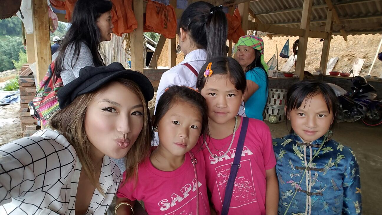 The mom is in the green headband, Ngu is in the white shirt and ponytail and the rest of the girls are her family.