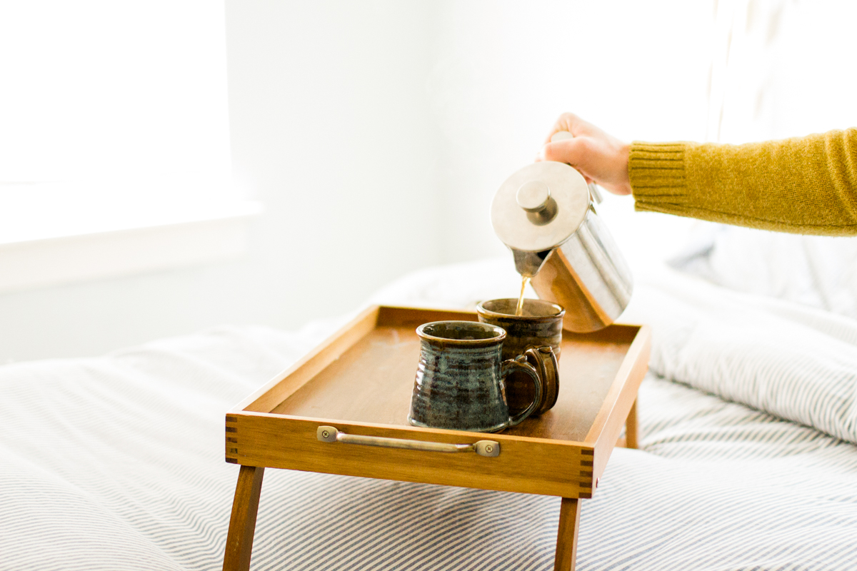 pouring coffee in an intimate in-home couples or engagment session in kansas city, MO
