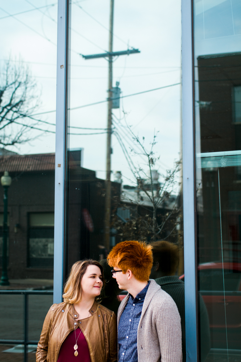 urban engaged or married couple reflected in a window engagment photography couples photography Westport Kansas City, MO