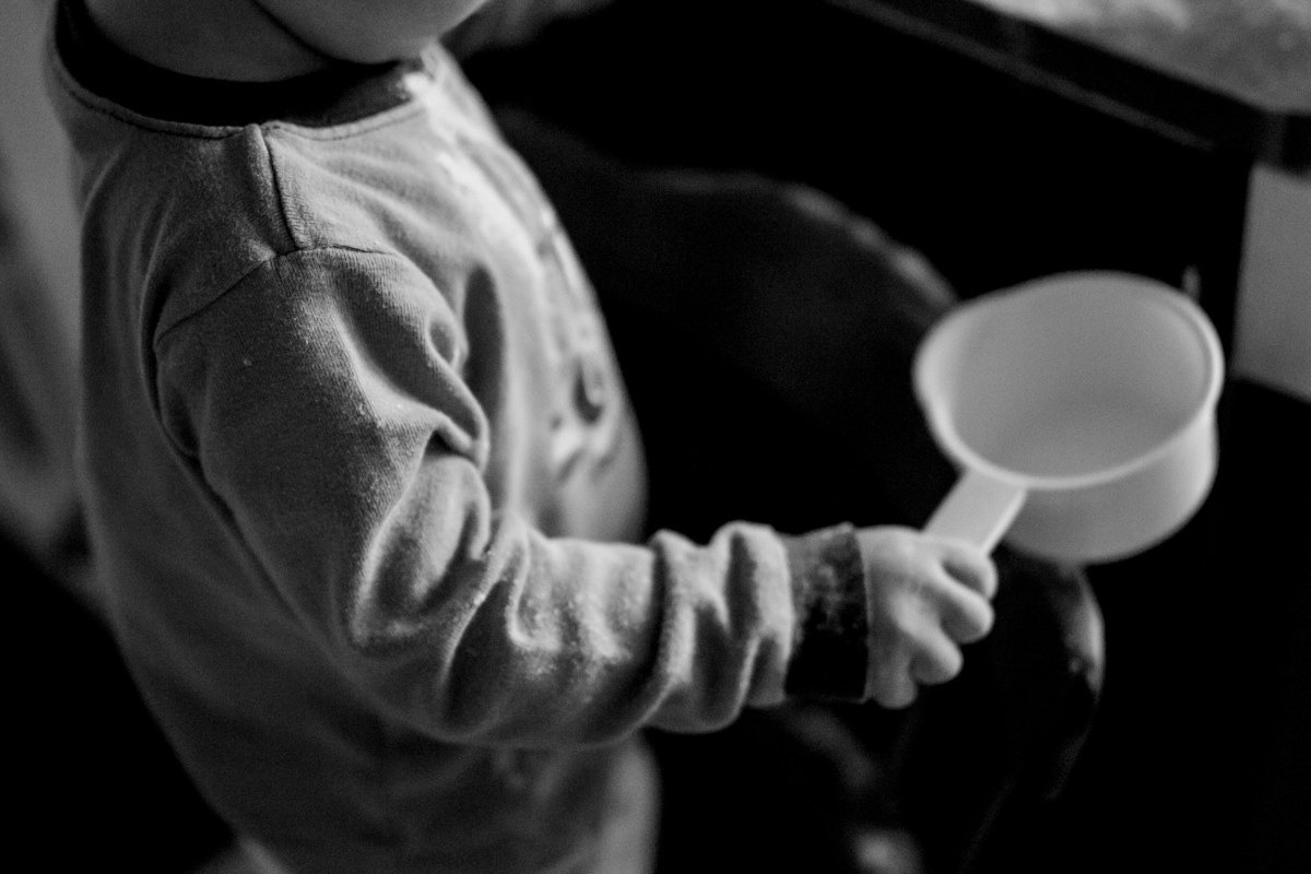 Kansas City, MO lifestyle family photographer boy cooking with mom family photography black and white photography
