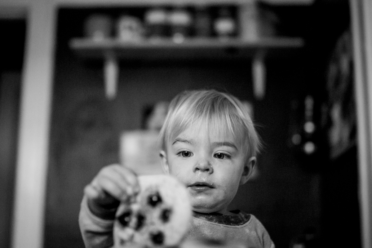 Kansas City, MO lifestyle family photographer boy with pancakes family photography black and white photography