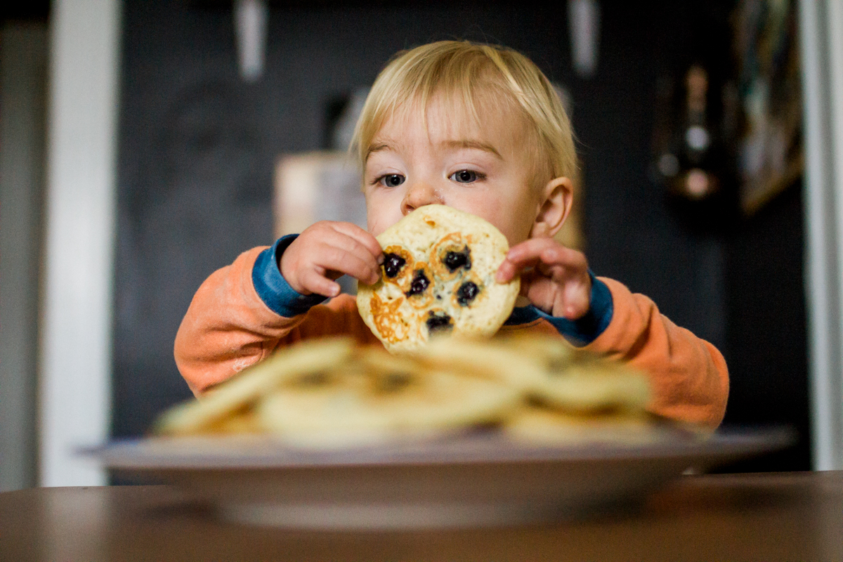 Kansas City, MO lifestyle family photographer boy with pancakes family photography