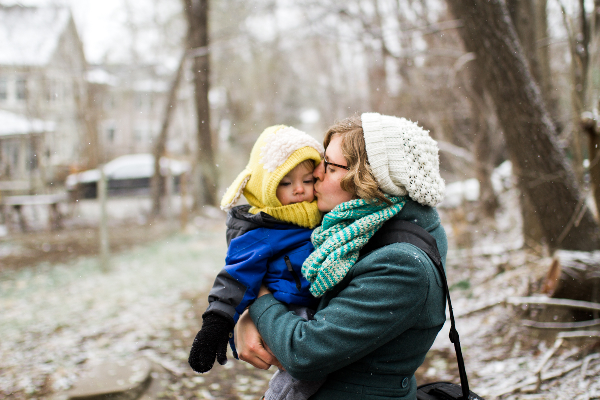 Kansas City, MO lifestyle family photographer mother  and son in the snow winter family photography