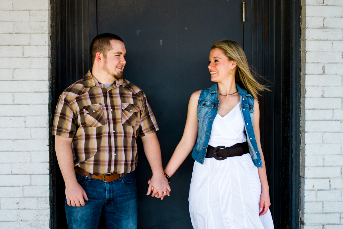 Couples session in Kansas City west bottoms couples photography holding hands